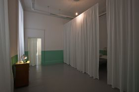 Ilya and Emilia Kabakov, The Mysterious Exhibition, 1998, Hospital Bed, Chairs, Bedside Locker, Miniature Theatre, Dimensions Variable, IMMA Collection, Purchase, 1999
