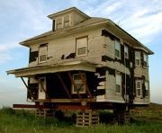 Richard Saxton, Jacked House #2, 2004, Light jet print on vorex, 16 x 12 inches, Courtesy the artist