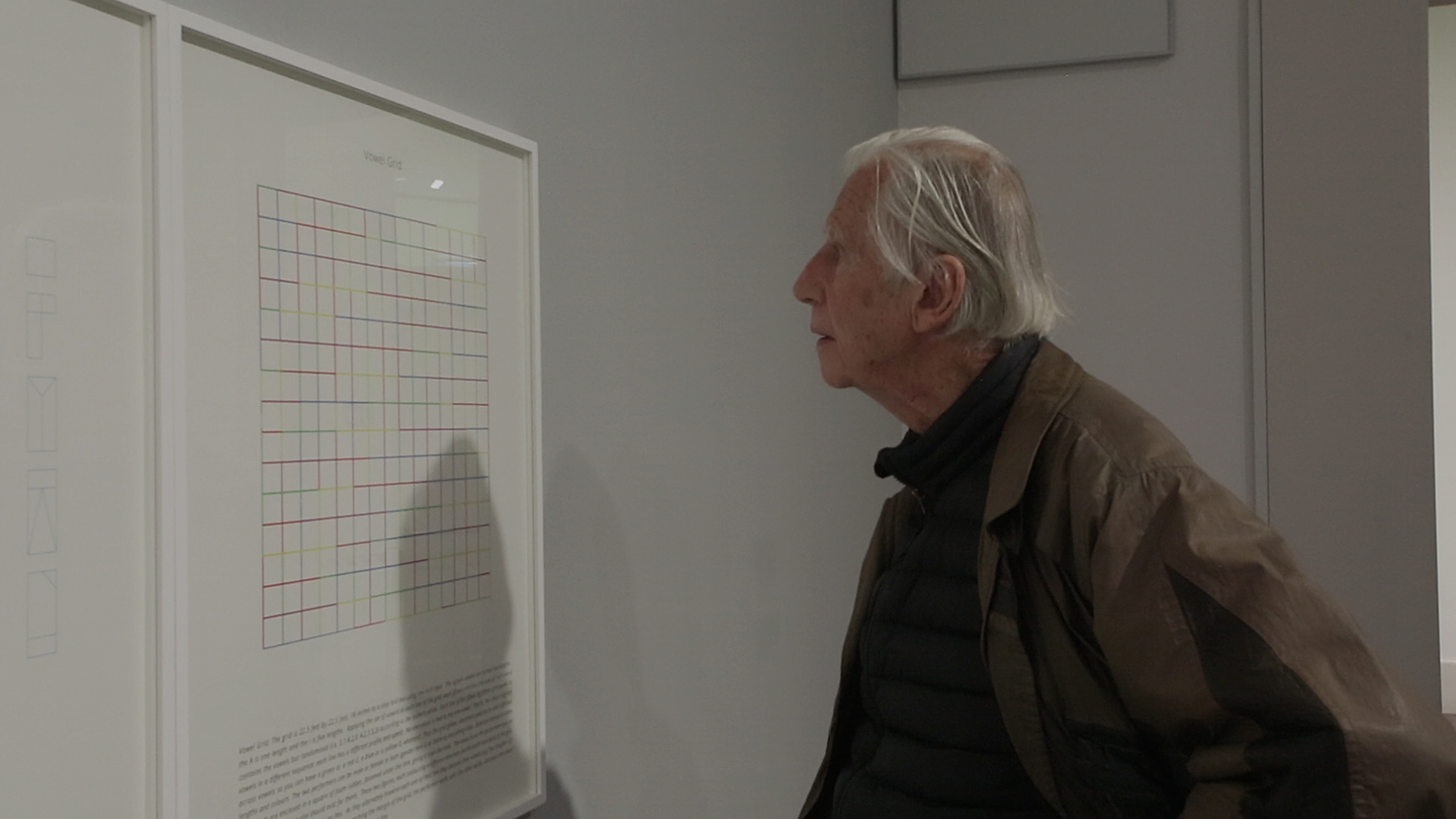 Brian O'Doherty viewing his Structural Plays series, produced in association with Stoney Road Press, during the launch of IMMA Collection: Brian O'Doherty Language and Space, Thursday 26th April 2018 Vowel Grid (2018), archival pigment print On loan Stoney Road Press Photography AlanJames Burns