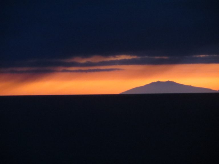 Sunset in Iceland mountain against orange sky