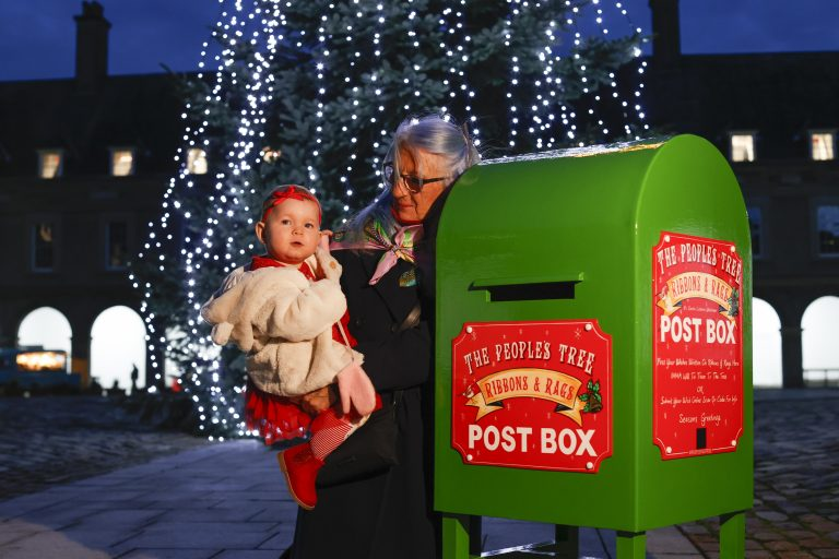 The People's Tree, pictured at the Irish Museum of Modern Art is Bernadette and Lisa Murphy with Penny Murphy, 17 months, from Inchicore posting their wishes on ribbons that will be tied to the impressive 35ft Christmas tree located in the courtyard