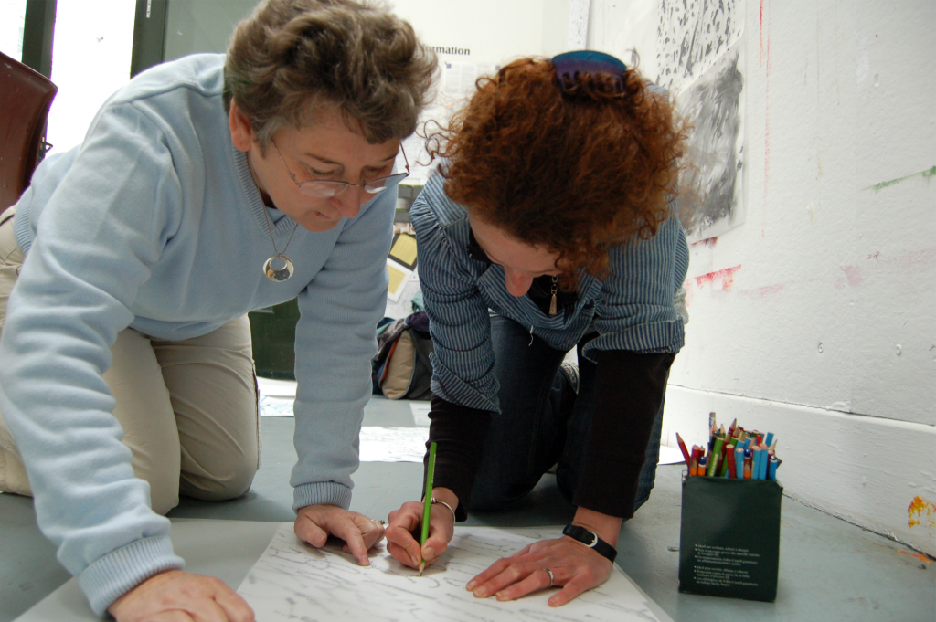 Artist Christine Mackey leading a 'Charcoal & Chocolate' workshop in response to Vik Munoz's exhibition, 2007